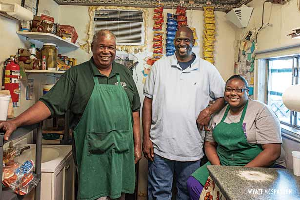 Pitmaster Bennie Washington with his son and grandaughter