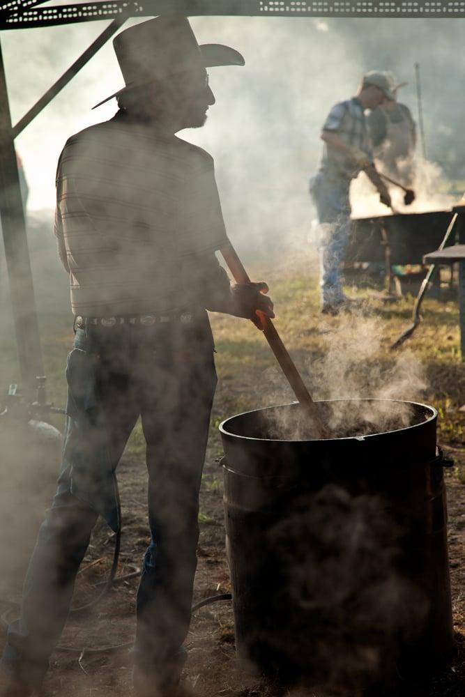 Stirring the beans in a 50 gallon cast-iron wash pot in Millheim