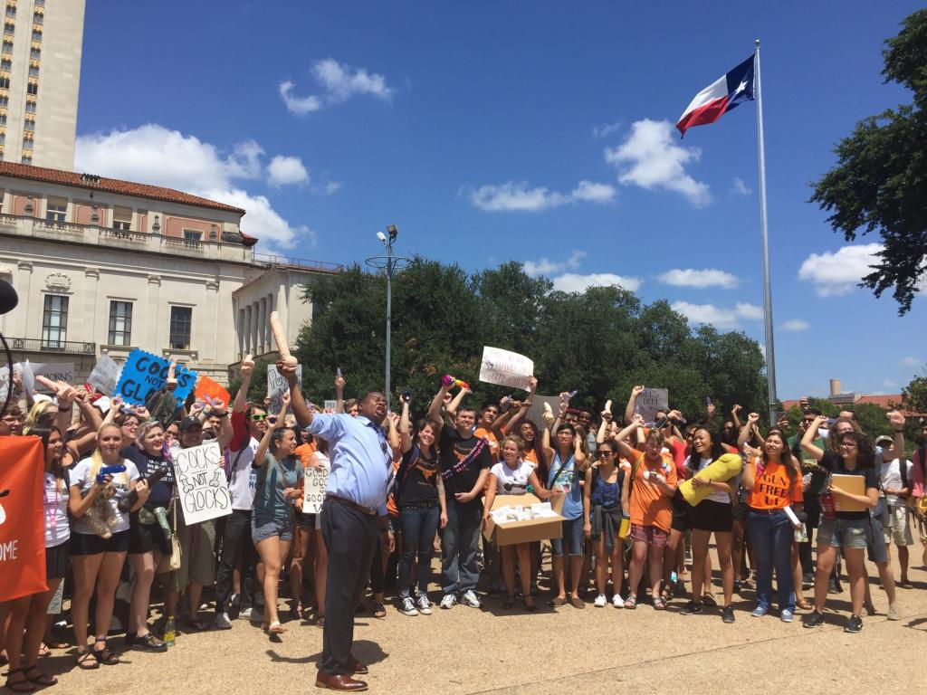 "Roy Wood Jr. from the Daily Show with Trevor Noah leads University of Texas at Austin Students in a ""Cocks Not Glocks"" chant on August 24, 2016."