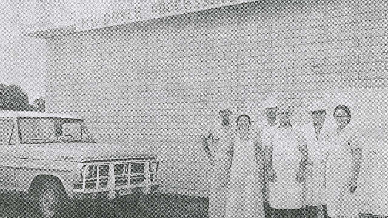 A 1974 newspaper photo of White (far left), Tootsie (second from left), and Hershel Doyle (fourth from left) with other market employees.