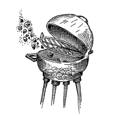 Fig. 3 — Grill Bank charcoal on one side and light a few pieces on the edge; you'll get steady low heat as the fire spreads across the coals. Place your meat away from the fire and cook with the lid down. For smoke, use wood chips, which slip easily through the grate and can be added continually.