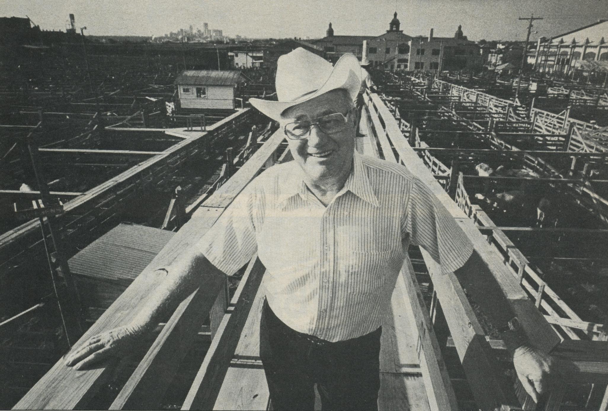 "President of the Stockyards Corporation, Elmo ""Mo"" Klingenberg, can remember when this was the ""heart and soul of Old Fort Worth."" The modern-day city, somewhat forgetful and upwind, rises on the horizon above his right shoulder."