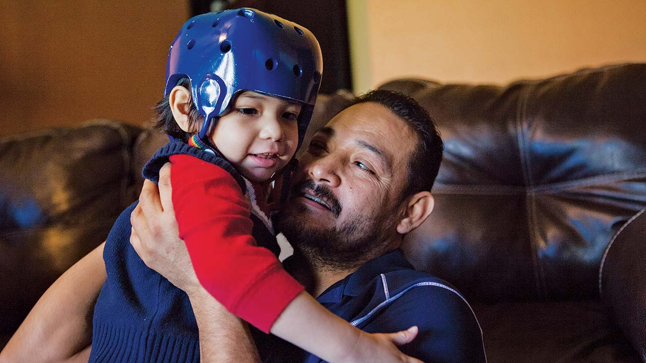 Rikki Adan, another participant in Cook Children's clinical trial, suffered more than thirty seizures a day before he joined the trial. He wears a helmet to protect against injury.